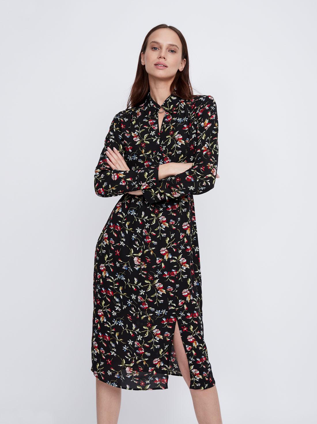Платье с патами на рукавах
