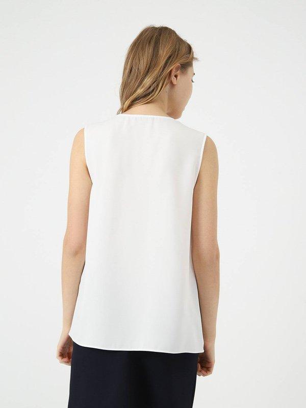 Блузка свободного кроя вид сзади